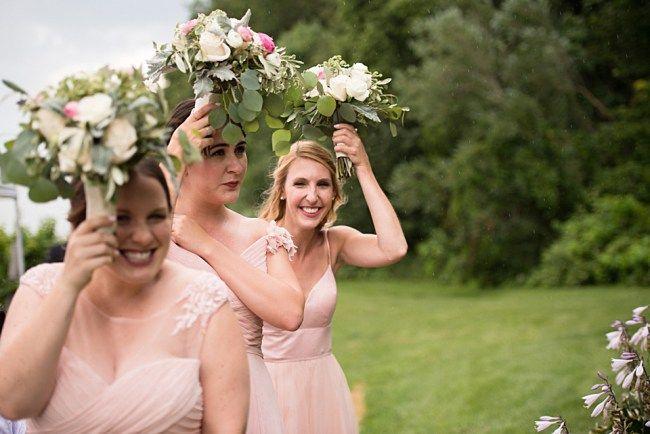 Toronto Wedding Photography, Alisha Lynn Photography - Inn on the Twenty + Cave Springs Winery: Laura + Alex Niagara on the lake Wedding. A bouquet makes the best umbrella during a little rain shower!
