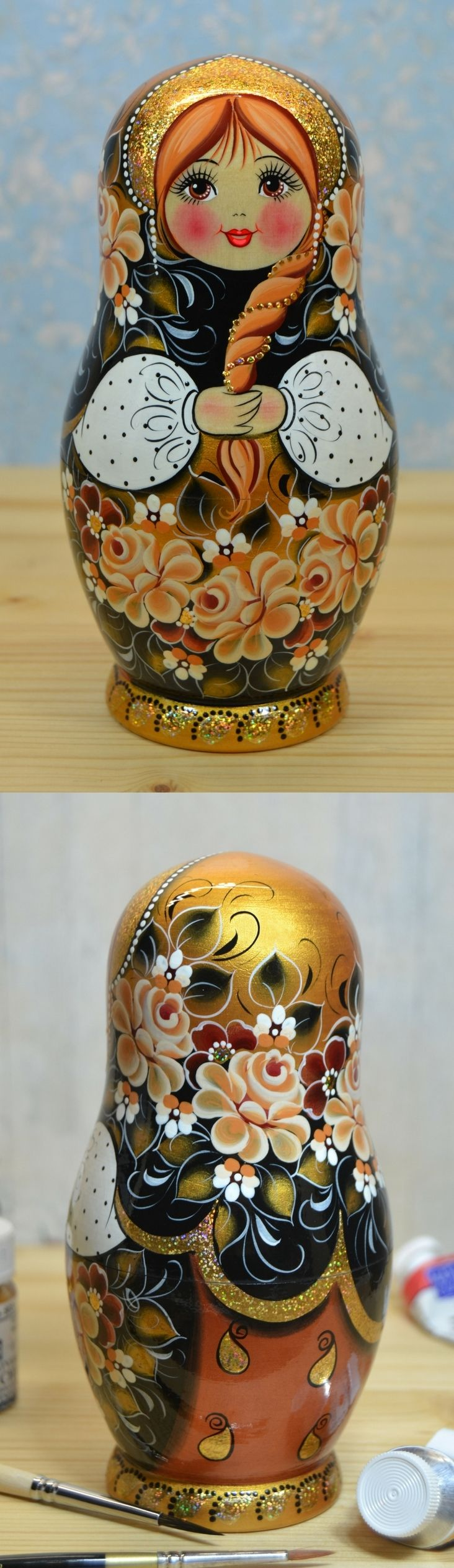 Russian nesting doll in black and gold decor, hand painted by artist Nadezhda Tihonovich. Find more lovely matryoshka dolls at: www.bestrussiandolls.etsy.com