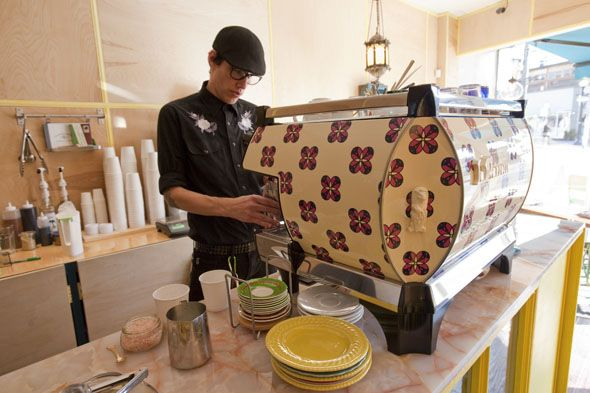 The La Marzocco machine at College Street's newest coffee shop is covered with a custom silkscreen adhesive in a Moroccan tile design, which...