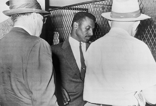 Civil Rights leader Fred Shuttlesworth being booked at the Birmingham Police Station in connection with attempts to desegregate buses. May 19, 1961.
