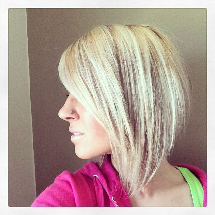Angled bob cut. Aline, reverse inverted bob, longer in the front shorter in the back.