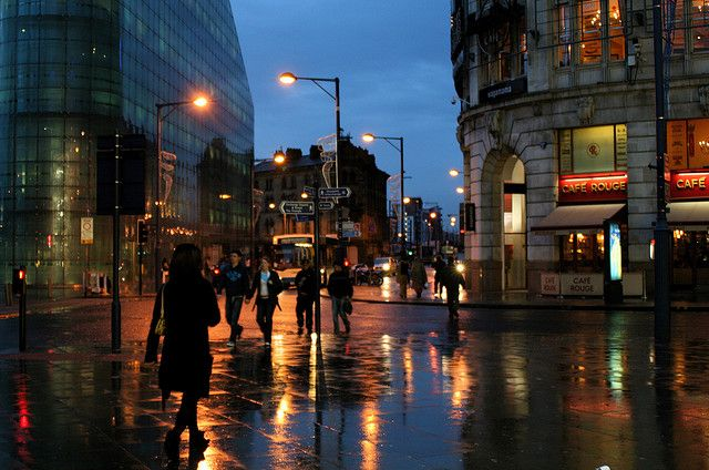 Night time in #Manchester The reflective pavements invite the dazzling lights of streetlamps and car headlights
