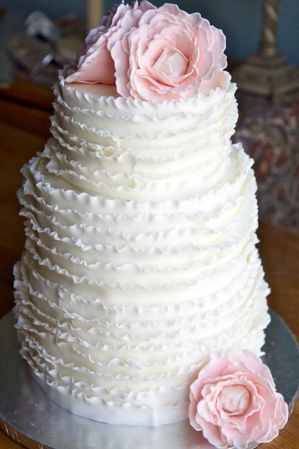 This cake is beautiful!!! 3 tier wedding cake. 6, 8, 10 inch yellow cake IMBC fondant frill work and fondant peonies.  TFL!