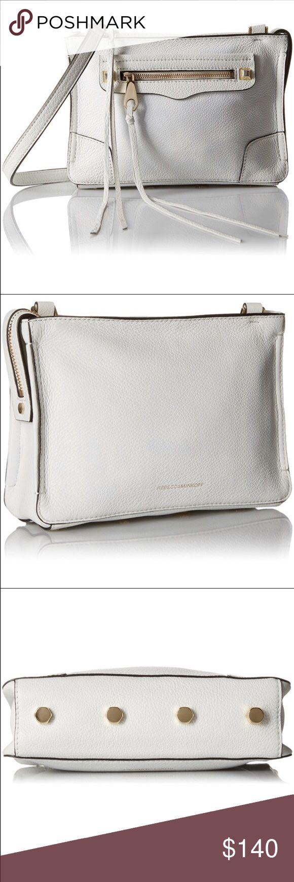 "Rebecca Minkoff Reagan Crossbody With moto-inspired styling and a streamlined silhouette, this Rebecca Minkoff crossbody is a cool pick for all your off-duty events, from date night to weekend errands.  Leather Imported Detachable adjustable crossbody strap Top zip closure; lined Exterior zip pocket, interior slip pocket Protective metal feet 9""W x 2""D x 6.5""H; 22"" to 26"" strap drop Rebecca Minkoff Bags Crossbody Bags"