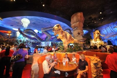 T-Rex Cafe.   I went to the one in KC and it was the coolest place I've ever had a meal. So much to look at, plan on being there for 3 hours if you go. Oh, and the sky lights up and rumbles for a meteor shower every 20 mins. Can't wait to take Eisley here.