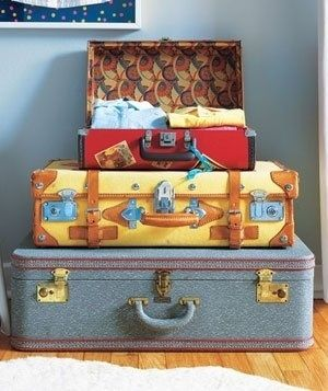 Keep dress-up clothes in vintage suitcases. | 41 Clever Organizational Ideas For Your Child's Playroom