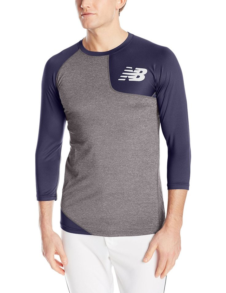 New Balance Mens Asym Baseball Left Shirt 92% Polyester/8% Spandex Fitted silhouette with a Dropped back hem. Flat lock seams decrease chafing. Body mapped ergonomic seaming Wicking and odor resistant 3/4 sleeve length.