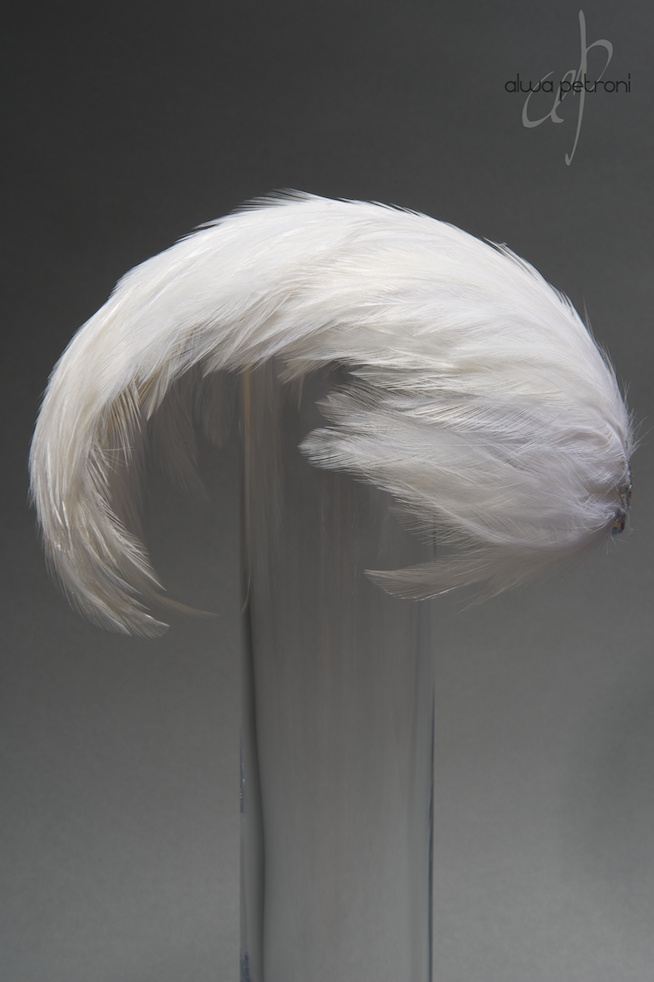 1950ies-style feather bandeau hat.    By Alwa Petroni