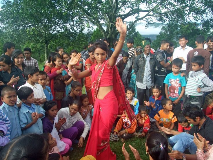 A woman dances at the Teej Program organized at Nuwakot Arghakhanchi, a remote district in Nepal, September 21, 2012.  (Photo: Mehar Singh KC/Nepal/VOA reader)12