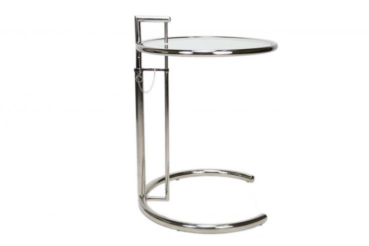 """""""Bijzet tafel Eileen Gray Gebaseerd op het ontwerp van Eileen Gray: De """"Adjustable table"""" Een echte design bijzetafel geschikt voor vrijwel ieder interieur. Dit bijzettafeltje is geheel conform de orginele specificaties van de Eileen Gray tafel. Het buizenframe is in hoogte verstelbaar. Het buizen-frame is gemaakt van het beste RVS (roestvast staal) en geheel verchroomd en de lassen sluiten perfect op elkaar aan."""""""