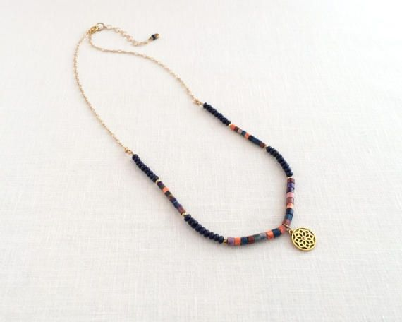 Blue lapis lazuli and stone heishi bead necklace with charm pendant by J Jewelry Design.