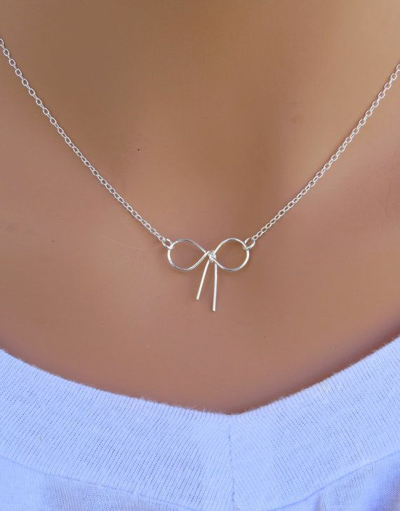 Tiny bow tie knot sterling silver necklace. by RoyalGoldGifts