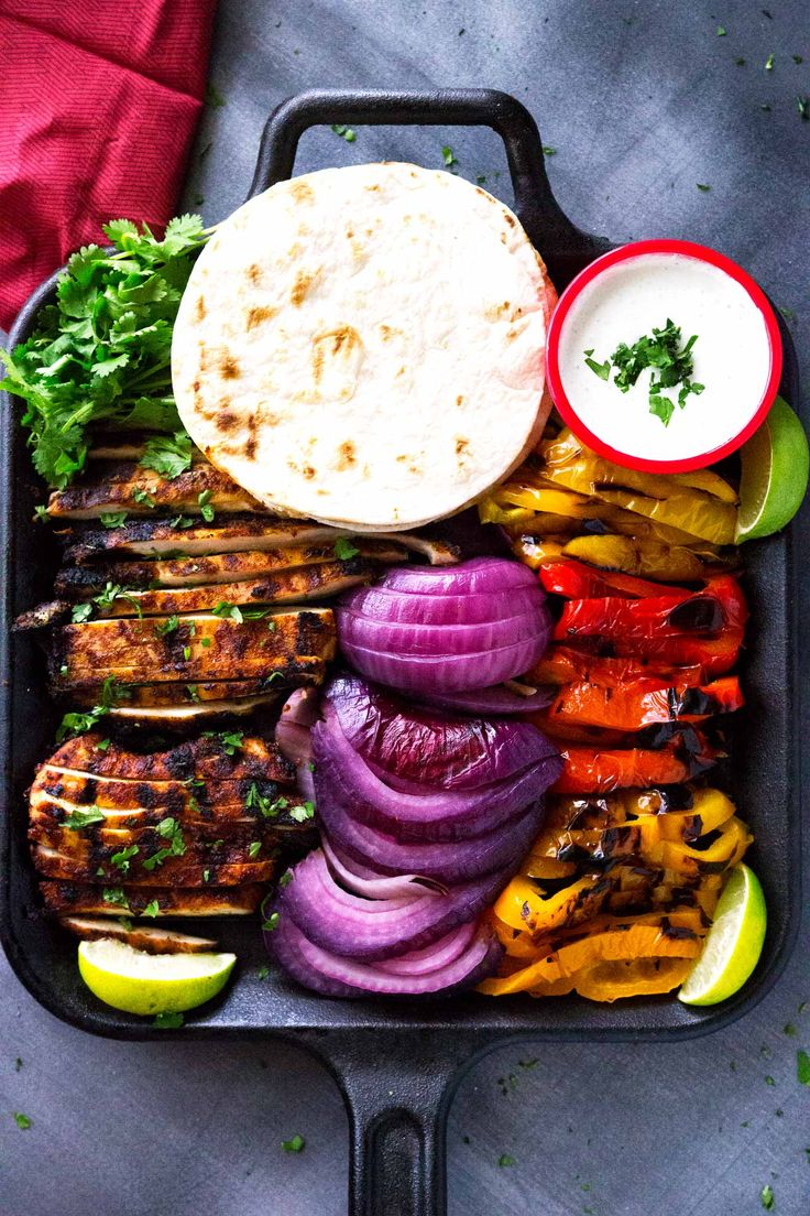 These 20 minute grilled chicken fajitas with jalapeño lime sauce are loaded with flavor. Homemade fajita seasoning, peppers, and chicken all grilled to perfection and topped with an easy jalapeño lime sauce.