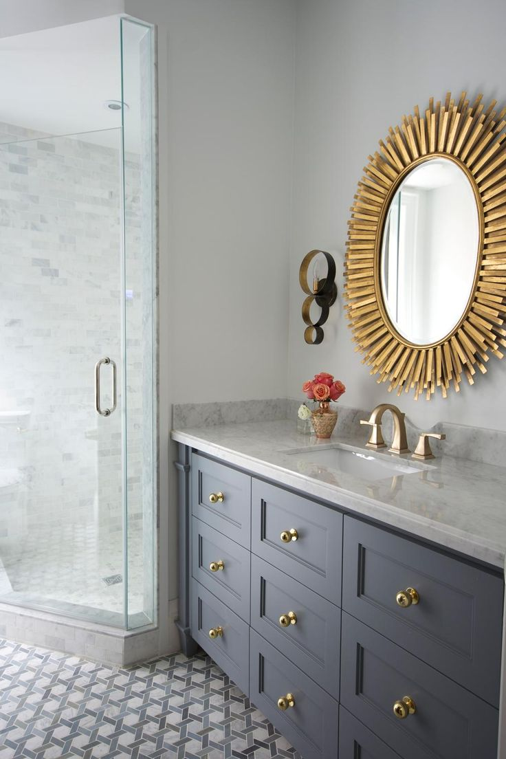 A gold mirror is a sure fire way to brighten up any bathroom. (especially if it's slate grey!)
