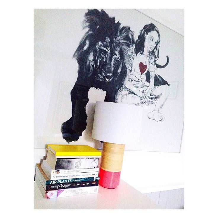 Days 23 & 24 of #GETtoknowyou  Read & Camera  This is the current pile of reading material next to my bed: parenty planty trashy and a notebook. Being looked over by my beloved lion and girl print by @john_simpson_art - and photo taken with my iPhone 5 as usual