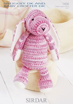 Sirdar 1456 Bunny. Uses #3(double knitting) weight yarn. Model is knit in Sirdar Snuggly Crofter DK.