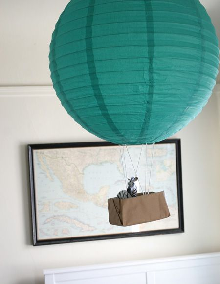Have you ever taken a ride in a hot air balloon? Me neither. Mr. Zebra has quite the life floating above Henry's bedroom like a king, surveying the scene. I think I'm going to make him a mini king'...