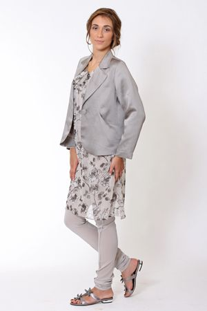 Smarten up with Dolly, a drape front pocket jacket. Under the jacket is Stellar, a silk tunic worn over Nomad silk leggings. The Darfish sandal completes the look.