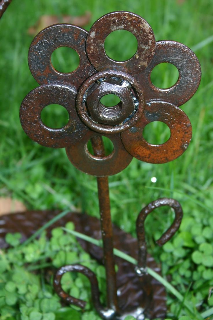 Washers and such welded together to make a cute flower garden stake.