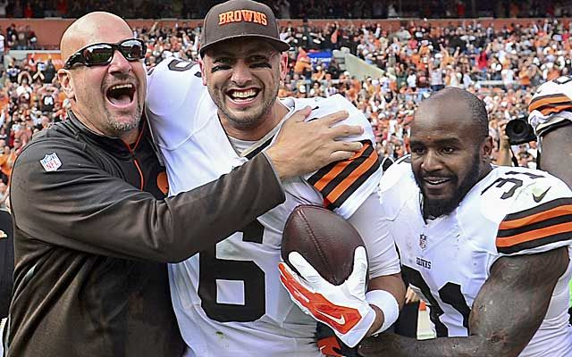 Mike Pettine and Brian Hoyer celebrate a big win over the Saints. (USATSI)