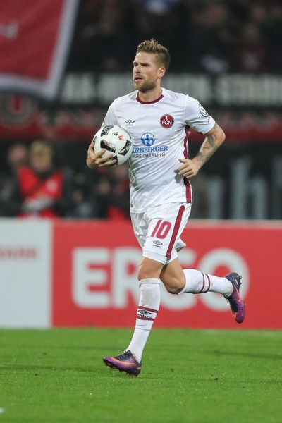 Tobias Kempe of Nuernberg celebrates his team's second goal during the DFB Cup match between 1. FC Nuernberg and FC Schalke 04 at Stadion Nuernberg on October 26, 2016 in Nuremberg, Germany.