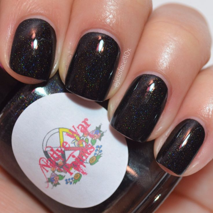 Holiday Party Dress is part of the Holiday Homecoming collection.This black holographic polish has a sprinkling of gold flakies.Full size bottles are 15mlMini size bottles are 5mlOpaque in 2-3 coats.