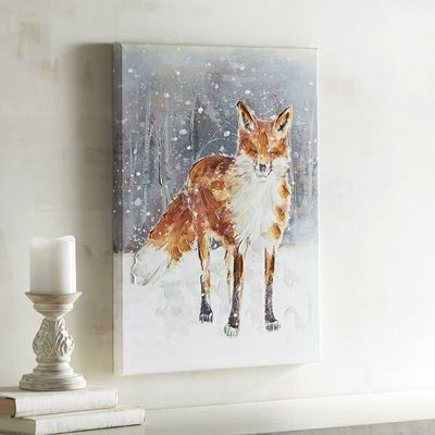 The fox says it's cold outside. Hand-painted amid a blustery, wintery scene, he's looking for somewhere warm to settle in this season. We're sure you'll find a  clever place to hang him in your home.