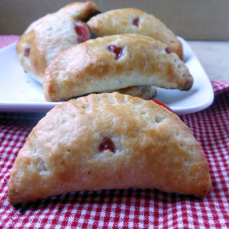 Strawberry rhubarb hand pies - a little taste of summer in a pocket. Perfect Fourth of July picnic dessert. But really, anytime you can find rhubarb and strawberries, these little hand pies would make super treats.