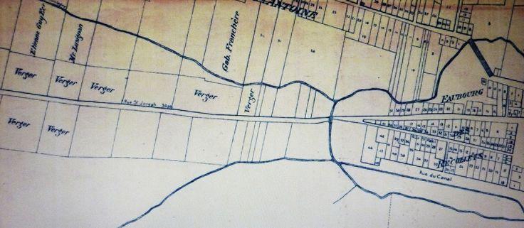 Archives BANQ /  Louis Charland (1772-1813). 1801, le canal Lachine n'est encore qu'un projet, un concept. Toutefois, Montréal traverse une phase d'expansion majeure. On entreprend le démantèlement des murs des Fortifications. Avant de quitter la Cité vers l'Ouest, par la rue Notre-Dame on longe le faubourg des Récollets et par la suite, la rue Notre-Dame change son nom pour Saint-Joseph, le paysage qui s'ouvre alors devant le voyageur n'est que terres cultivées e...