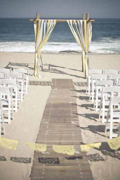Wood planks great for a beach wedding!   14 Unique Aisle Runners: wood or boardwalk   Photo: Aaron Young Photography