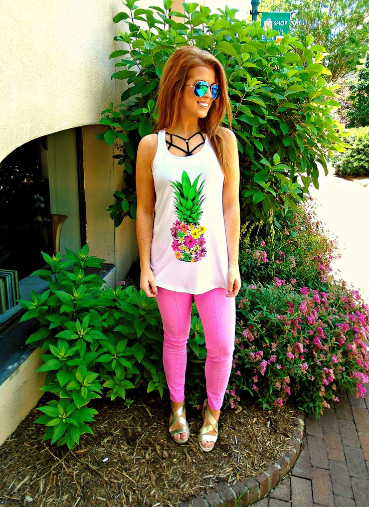 Description: We are swooning over this super cute floral pineapple tank! Vibrant in color this tank looks great with anything! Wear it with jeans, shorts, or your favorite bathing suit to bring some c