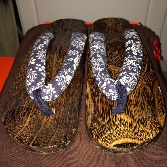 Hawaiian Flip Flops Blue/white design print wooden flip flops. Brown shiny wood finish. Rubber bottom sole. Flip Flop Shoes