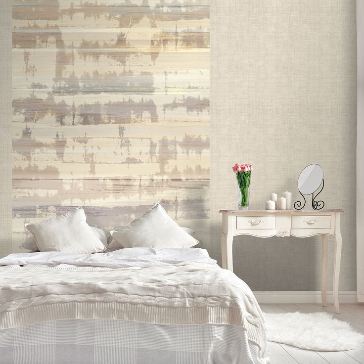 Tie-die effect wallpaper looks great as a feature wall for this bedroom.
