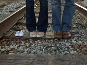 cute pregnancy announcement picture by lorene.  would be adorable with all the siblings' shoes too.