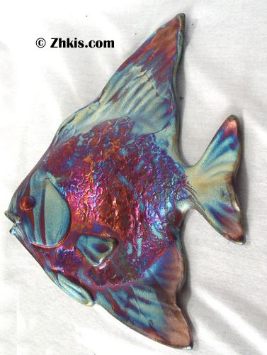 Large fish wall plaque. Made of raku pottery and very elegant.large in size at 13 inches tall. A great piece for a bathroom or beach house. A beautiful piece of raku.