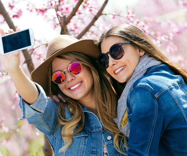 Ever wonder how some people's selfies turn out so great? Check out our guide on how to take a good selfie with tips from real photographers!
