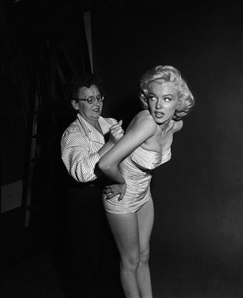 Marilyn Monroe getting fitted into her outfit. <3