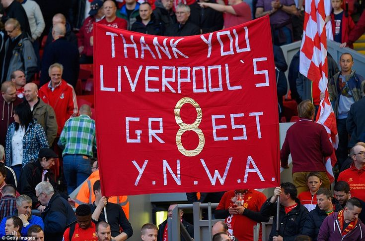 The Greatest: A sign held by the Liverpool pays tribute to arguably the best player to wea...