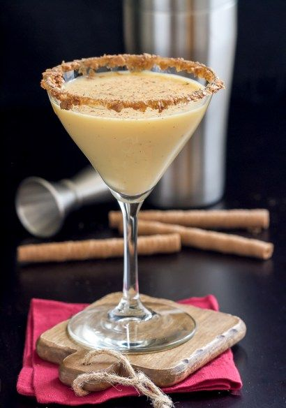 Store bought egg nog is used in this Egg Nog Martini recipe along with vanilla vodka, almond liqueur and pumpkin pie syrup.