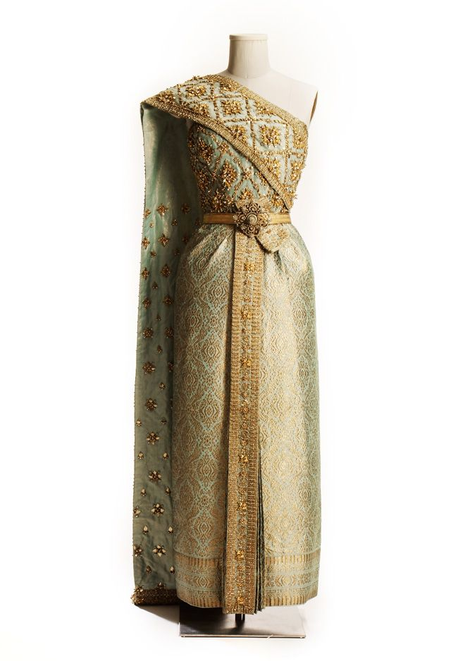 hmq's sirikit thai traditional dress (thai chakri) Pierre Balmain, 1969. Materials: Silk, Metal and Plastic. Technique: Brocade and Embroidery.