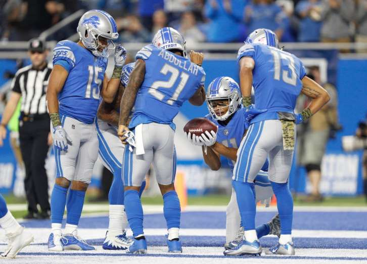 """Best NFL celebrations of 2017 - November 15, 2017:  Detroit Lions running back Ameer Abdullah (21) mimics the viral """"Salt Bae"""" video"""" with wide receiver Marvin Jones (11) wide receiver T.J. Jones (13) and wide receiver Golden Tate (15) after running for a touchdown during the second quarter against the Cleveland Browns at Ford Field."""