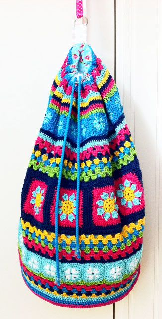 I want to turn an old crocheted blanket into a big sack like this.