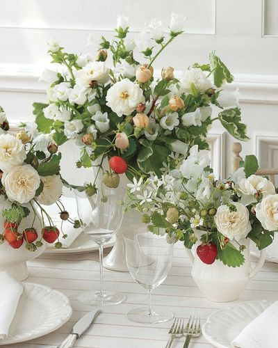 white arrangements with strawberries!