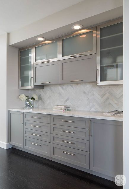 Herringbone Calacatta tile backsplash. The gray painted cabinets