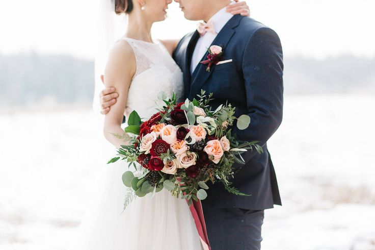 Our bride and groom were married on a snowy winter day at @bvrrestaurant in Calgary Alberta. The bride held a burgundy and peach bouquet of ranunculus, roses and anemones! Photo: http://stephaniecouture.ca/ Bouquet: www.flowersbyjanie.com