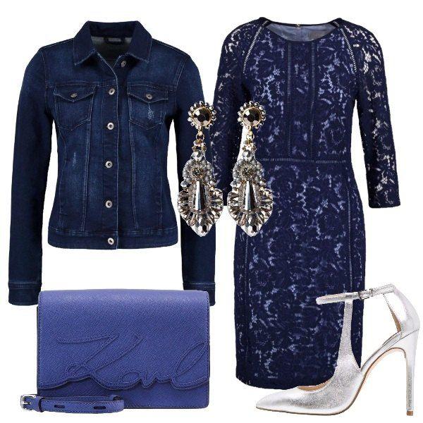 Questo outfit, che gioca sui contrasti, abbina l'eleganza di un vestito in pizzo con gonna longuette, delle décolleté argentate e degli orecchini che luccicano a dei capi più sportivi come una tracollina blu e un giubbotto di jeans.