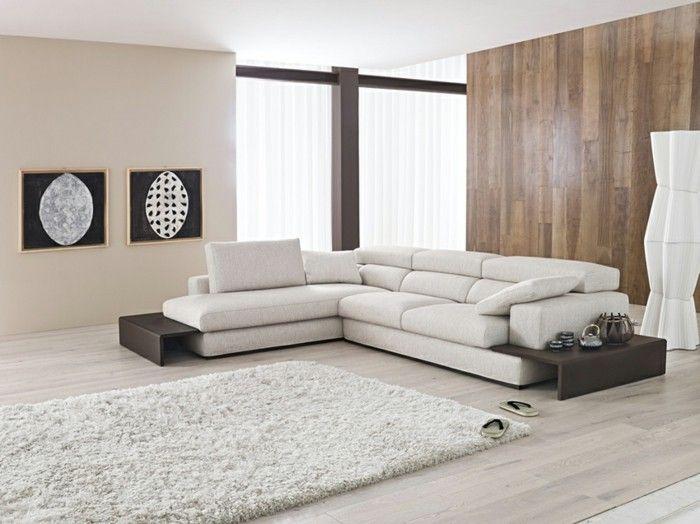 canapé d'angle arrondi beige pour le salon taupe avec grandes fenêtres