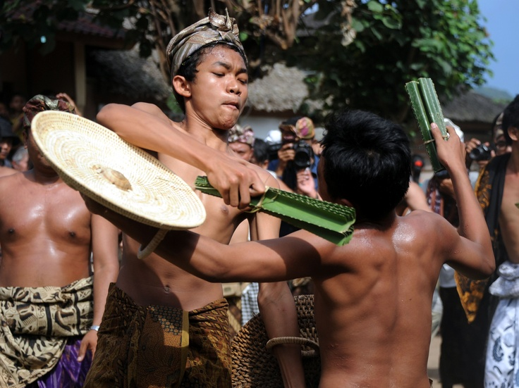 Balinese villagers battle using thorny pandanus leaves and rattan shields during the annual Perang Pandan (Pandanus War) event in Tenganan village, on Karangasem-Bali island on June 8, 2012. Although their bodies are splattered with blood, the men are proud as they believe they have made a sacrifice to the gods, to balance the human body and the universe. (AFP Photo/Sonny Tumbelaka)
