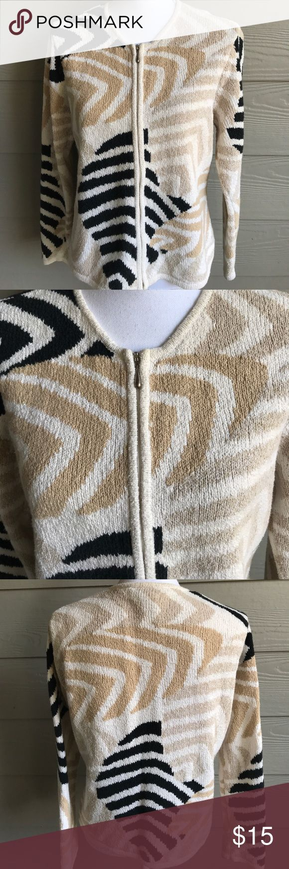 "Talbots zip up sweater. Talbots petites zip up ramie/cotton sweater. Beige, black, tan and cream design. Arm pit to arm pit. 20"".  Sleeve length. 23"". Top to bottom. 23"" Talbots Sweaters Cardigans"