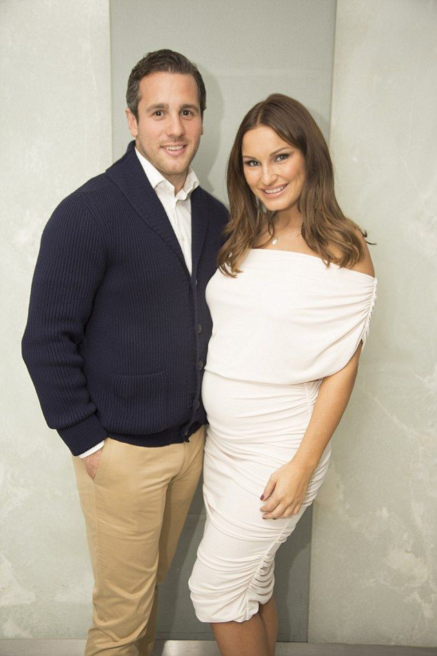 Happy couple: Pregnant Sam Faiers was joined by boyfriend Paul Knightley on Thursday as she prepared for a beauty launch in London